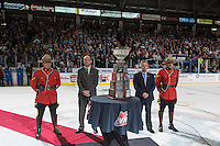 KELOWNA, CANADA - MAY 13: WHL Vice President of Hockey Richard Doerksen and WHL Commission Ron Robison together with the RCMP stand on the ice to present the Kelowna Rockets with the WHL Championship trophy on May 13, 2015 during game 4 of the WHL final series at Prospera Place in Kelowna, British Columbia, Canada.  (Photo by Marissa Baecker/Shoot the Breeze)  *** Local Caption *** Richard Doerksen; Ron Robison;