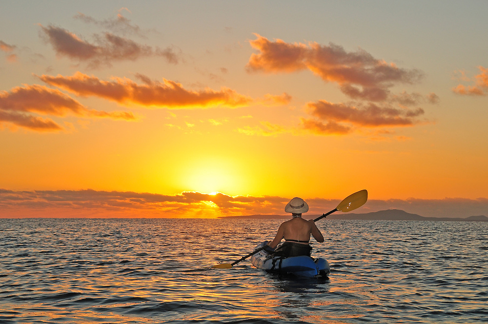 Regula Heeb kayaking at sunrise at Ventana Bay, near El Sargento, Sea of Cortez, Baja California Sur, Mexico