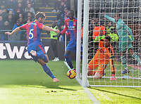 Football - 2018 / 2019 Premier League - Crystal Palace vs. Arsenal<br /> <br /> Pierre - Emerick Aubameyang of Arsenal turns away after the ball had crossed the line for goal no 2 as James Tomkins clears in vain, at Selhurst Park.<br /> <br /> COLORSPORT/ANDREW COWIE