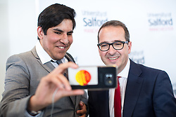 © Licensed to London News Pictures . 15/08/2016 . Salford , UK . Labour leadership candidate OWEN SMITH (r) poses for a selfie with a supporter after delivering a speech on the National Health Service , at the Mary Seacole Building at Salford University . Photo credit : Joel Goodman/LNP