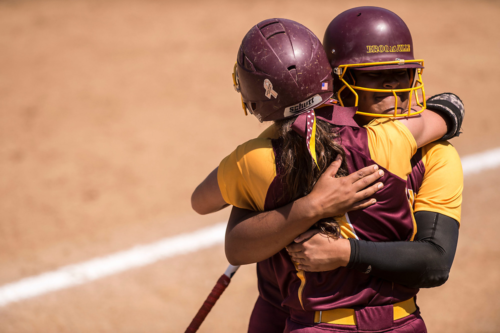 SALEM, VA - June 10: Alexis Ferguson and Jordan Dail hug after the end of an inning on Saturday, June 10, 2017 in Salem, Va. (Photo by Jay Westcott/The News & Advance)