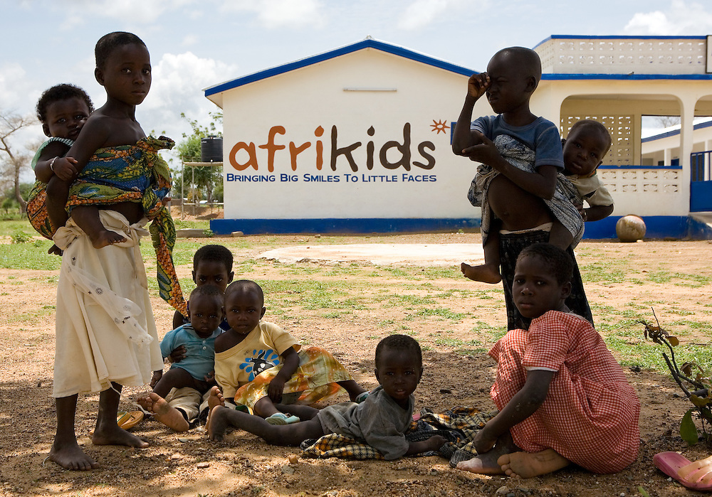 Nine children from Afrikids, escape the heat of the sun and rest in the shade in Bolgatanga, Ghana. Afrikids is a Child Rights Organisation, which works alongside indigenous communities in Ghana to improve the quality of life for rejected and vulnerable children. Targeting the root causes of the children's problems, by improving community support services and by providing access to basic education and primary health care.
