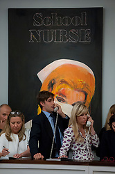 "© Licensed to London News Pictures. 28/06/2017. London, UK. ""School Nurse"", 2005, by Richard Prince sold for a hammer price of GBP3.5m (estimate GBP3.5-4.5m)at Sotheby's Contemporary Art evening sale in New Bond Street, which featured pioneering works from the Pop Art genre. Photo credit : Stephen Chung/LNP"