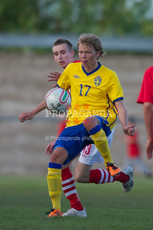 FLINT, WALES - Thursday, May 12, 2011: Wales' Declan Dalley in action against Sweden's Joakim Olausson during the Men's Under-17's International Friendly match at Cae-y-Castell. (Photo by David Rawcliffe/Propaganda)