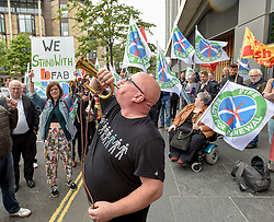 Campaigners, including BiFab worker Frankie Proctor on a bugle, from the Ready for Renewal campaign picketed the Edinburgh offices of energy firm EDF, to demand answers on their decision to have wind turbine jackets built in Indonesia rather than idle Fife yards that are only ten miles from the firm's proposed wind farm site.<br /> <br /> © Dave Johnston / EEm