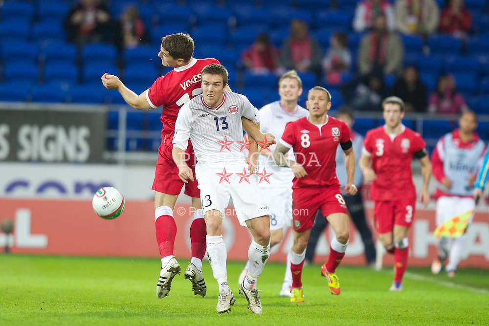CARDIFF, WALES - Saturday, November 12, 2011: Wales' Sam Vokes in action against Norway's Espen Ruud during the international friendly match at the Cardiff City Stadium. (Pic by Vegard Grott/Propaganda)