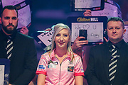 Fallon Sherrock (England), walk-on, before her game against Mensur Suljovic (Serbia) (not in picture), during the PDC William Hill World Darts Championship at Alexandra Palace, London, United Kingdom on 21 December 2019.