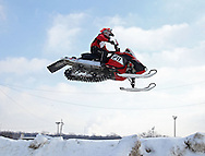 Reggie Reicks of Center Point gets some air at the Frozen Few 1st Inaugural Amateur Sno-X Race held at Hawkeye Downs, 4400 6th Street SW in Cedar Rapids on Saturday January 22, 2011. 1,200 people turned out to watch over 50 racers in 12 divisions at the event sponsored by the Frozen Few Snowmobile Club. A portion of the proceeds went to the Spina Bifida Association of Iowa. The next race is February 19th.