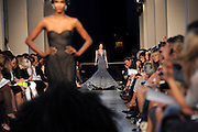 The Zac Posen Spring 2012 collection is modeled Sunday, Sept. 11, 2011, during Fashion Week in New York. (AP Photo/Diane Bondareff)