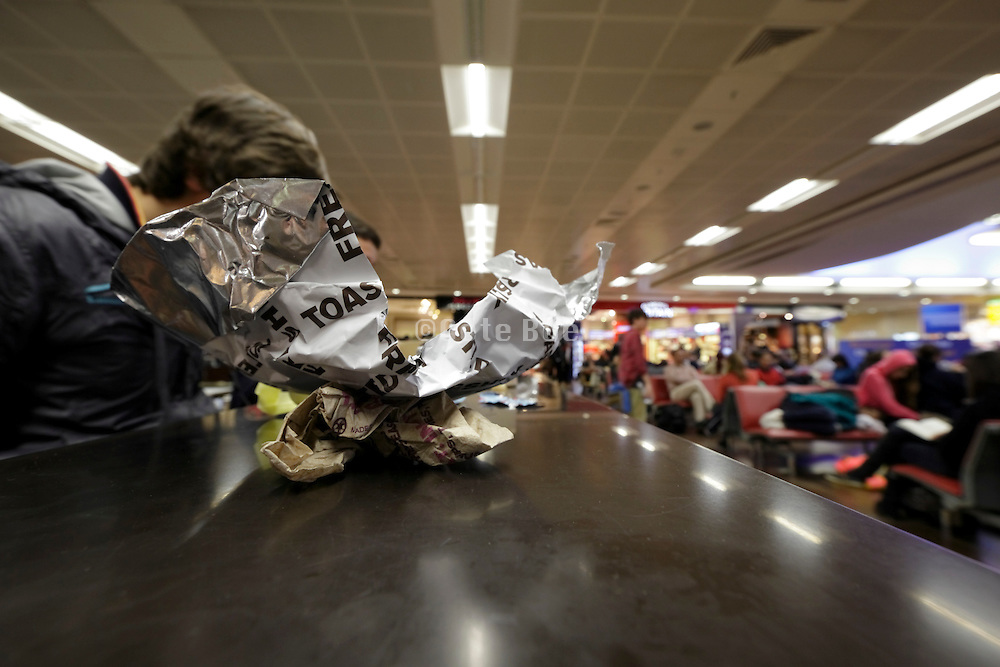 food eating and packaging trash at airport layover travelers terminal Heathrow England