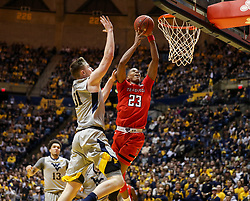 Feb 26, 2018; Morgantown, WV, USA; Texas Tech Red Raiders guard Jarrett Culver (23) shoots a layup while defended by West Virginia Mountaineers forward Logan Routt (31) during the first half at WVU Coliseum. Mandatory Credit: Ben Queen-USA TODAY Sports