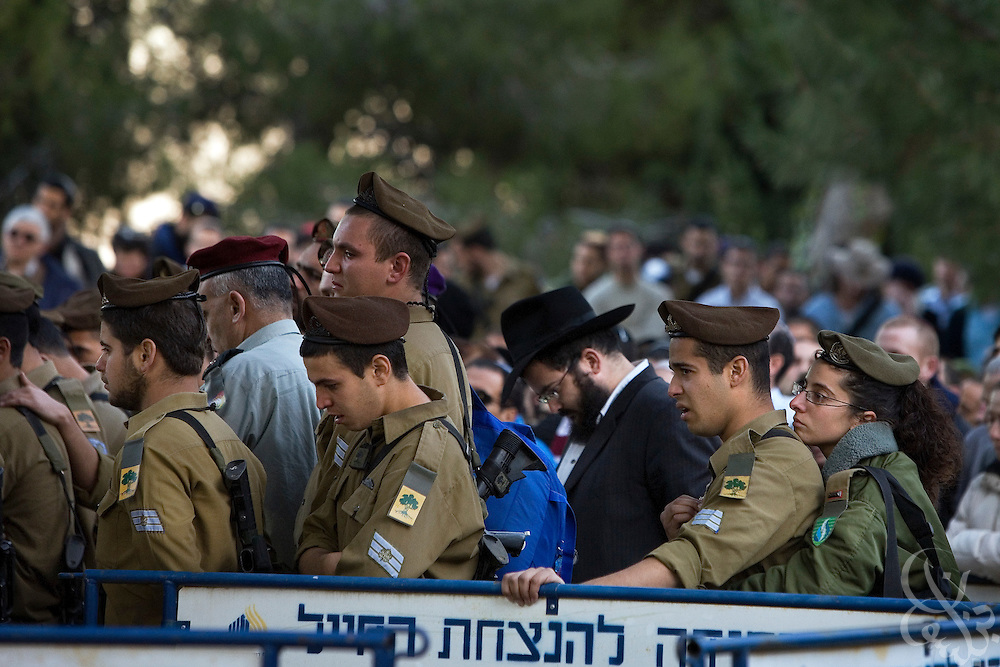 Israeli soldiers and other mourners take part in the funeral of Major Dagan Vertman, 32,  at the Mt. Herzl cemetery in Jerusalem, Tuesday, Jan. 6, 2009. Vertman and two other soldiers were killed Monday night when an  Israeli tank mistakenly fired on their position in an apparent friendly-fire incident according to the Israeli army.