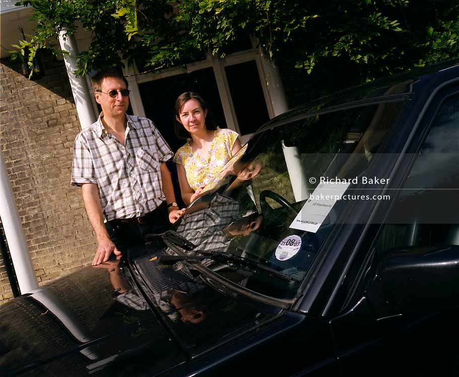 Ordinary husband and wife Mark and Christine Easterfield stand awkwardly with their Volvo car outside their large home near Cambridge, England. They are among the thousands of people who have each paid the $200,000 fare for seats on Richard Branson's Virgin Galactic space flights. Aboard the re-usable space vehicle will be 6 passengers, each of whom will have paid $200,000 for the 40 minute flight to 360,000 feet (109.73km, or 68.18 miles) and to experience just 6 minutes of weighlessness.   Flights start around 2009/10 from a Mojave desert test facility but therafter, at the new Philippe Starck-designed SpacePort America, New Mexico, USA. a 27 square mile, $225 million headquarters and mission control facility near Las Cruces.  .