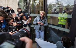 © Licensed to London News Pictures. 02/09/2015. London, UK. Actress Emma Thompson and other protesters from Greenpeace broke a legal injunction preventing activists from approaching the Shell Building today. Thompson and others attached posters to the building carrying the names of thousands of people who have signed a petition demanding Shell withdraw from Arctic oil exploration. Photo credit : James Gourley/LNP