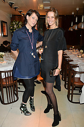 Left to right, CHARLOTTE STOCKDALE and MALIN JEFFERIES at a dinner to celebrate the publication of Obsessive Creative by Collette Dinnigan hosted by Charlotte Stockdale and Marc Newson held at Mr Chow, Knightsbridge, London on 9th February 2015.