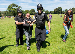 © Licensed to London News Pictures; 12/07/2020; Bristol, UK. A man who says he is homeless is arrested by police for being drunk and disorderly at a protest rally by All Black Lives Bristol in Eastville Park, though witnesses say he was not being aggressive to anyone before he was arrested. The event features a diverse group of speakers including spoken word performance, and representation from black-led businesses, charities and organisations in the city. All Black Lives Bristol is part of All Black Lives UK which is separate from the Black Lives Matter Activist Coalition, and are not affiliated with either Black Lives Matter USA or the political arm of the Black Lives Matter (Activist Coalition) UK who are purported to be affiliated with BLM USA.<br /> Five people behind Bristol's All Black Lives movement organised the protest that made headlines around the world.when Colston's statue was toppled from its plinth, dragged through the city centre and thrown into Bristol Harbour, though they did not organise what happened to the statue that day. The protest on 07 June was in protest for the memory of George Floyd, a black man who was killed on May 25, 2020 in Minneapolis in the US by a white police officer kneeling on his neck for nearly 9 minutes. The killing of George Floyd has seen widespread protests in the US, the UK and other countries. Photo credit: Simon Chapman/LNP.