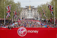 The mass of runners head along The Mall towards the finish with the Queen Victoria Memorial and Buckingham Palace in the background at the Virgin Money London Marathon, Sunday 26th April 2015.<br /> <br /> Dillon Bryden for Virgin Money London Marathon<br /> <br /> For more information please contact Penny Dain at pennyd@london-marathon.co.uk