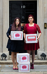 © Licensed to London News Pictures. 08/10/2018. London, UK. Natasha Devon MBE and Luciana Berger MP, and other supporters of the 'Where's Your Head At?' campaign deliver a petition to Downing Street, calling for a change in the law, to give mental health equal importance to physical health in the workplace. Photo credit : Tom Nicholson/LNP