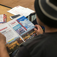 Travis Begaye looks through a packet with information about college admission and financial aid at Gallup Central high school in Gallup Thursday. The school hosted an information night for students and parents to learn about how to apply and succeed in college.