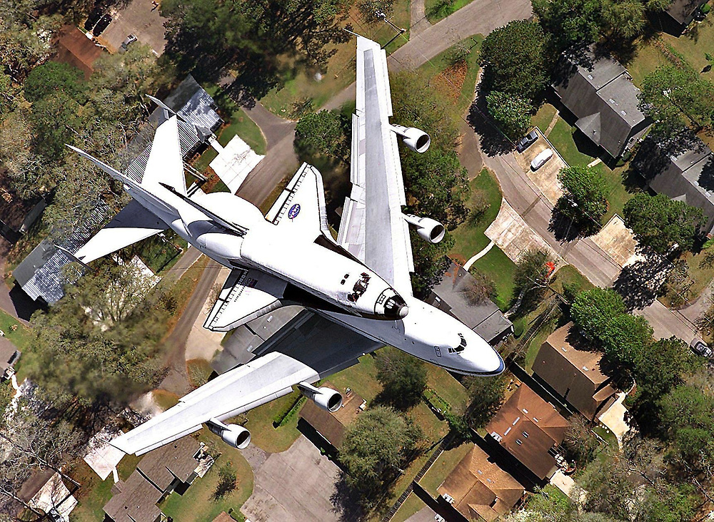 The Space Shuttle Columbia flies over a Tallahasse, Fla. neighborhood riding piggyback on a 747 Monday, March 5, 2001, heading for the Kennedy Space Center. The Columbia is the oldest shuttle in the fleet. (Photo by Craig Litten/Tallahassee Democrat)