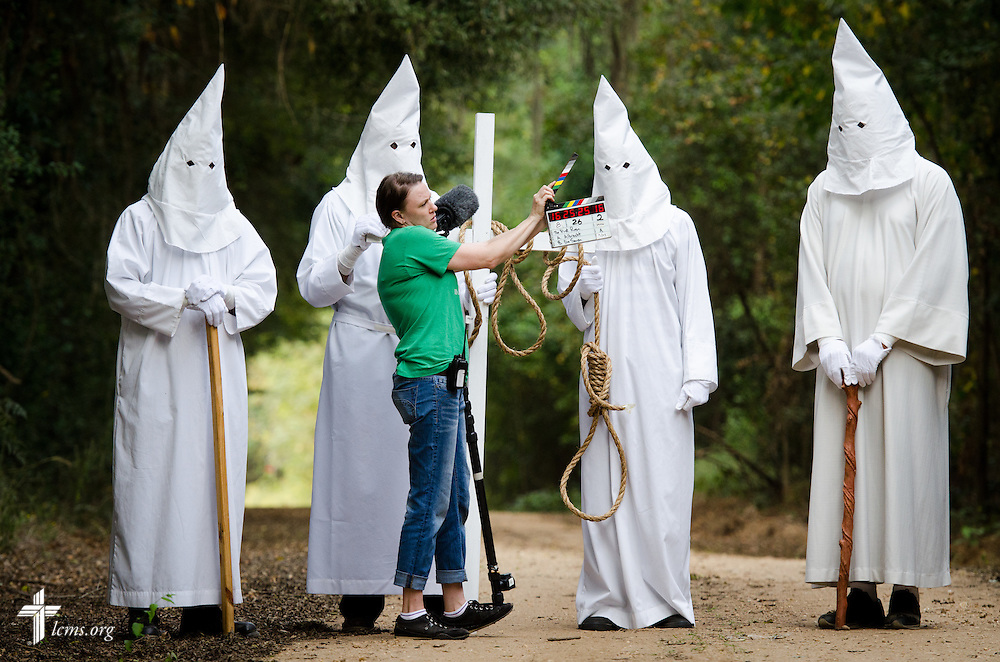 Assistant Amanda Booth uses the slate at the beginning of a take with actors dressed as KKK members during the final day of filming for 'The First Rosa' documentary on Thursday, September 25, 2014, near Selma, Ala. LCMS Communications/Erik M. Lunsford