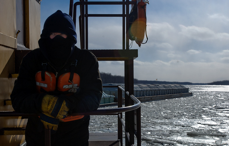 Trumbull River Service deckhand Bill Beard working on a cold February day on the Illinois River.