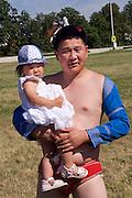 Baden bei Wien, Lower Austria. Naadam Festival of OTSCHIR (Austrian-Mongolian Society) at the Trabrennbahn.<br /> Traditional wrestling.