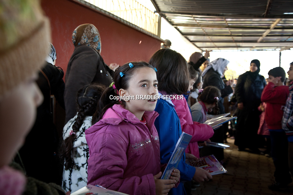 Top students are rewarded with new books, pens and golden stars, at the Albashayer School for Syrian refugee children, Antakya, Turkey. 14/12/2012. Bradley Secker for The Washintgon Post