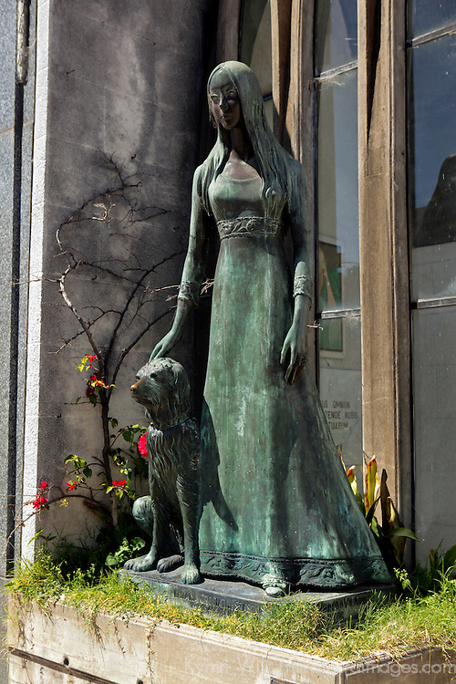 South America, Argentina, Buenos Aires. Statue of woman and dog at La Recoleta Cemetary.