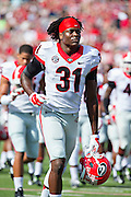 LITTLE ROCK, AR - OCTOBER 18:  Chris Conley #31 of the Georgia Bulldogs warming up before a game against the Arkansas Razorbacks at War Memorial Stadium on October 18, 2014 in Little Rock, Arkansas.  The Bulldogs defeated the Razorbacks 45-32.  (Photo by Wesley Hitt/Getty Images) *** Local Caption *** Chris Conley