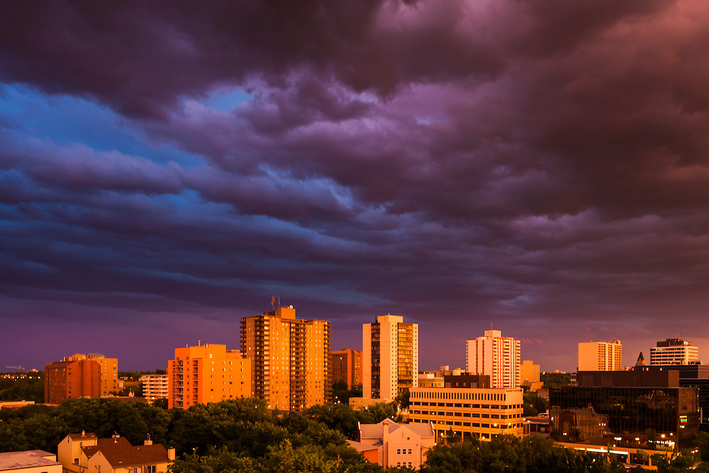 Saskatoon skyline, stormy evening sunset. This image makes outstanding wall decor as a metal print.