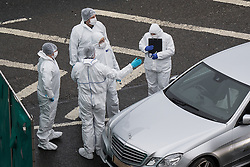 © Licensed to London News Pictures. 03/01/2017. Huddersfield, UK. Forensic scenes of crime officers at the scene of a bullet riddled silver Audi car at the slip road at Junction 24 of the M62 motorway in Huddersfield . West Yorkshire police have announced a man has died following the discharge of a police firearm , during what they describe as a pre-planned operation , yesterday evening (2nd January 2017) . Photo credit : Joel Goodman/LNP