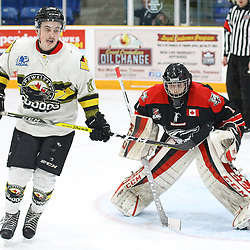 """TRENTON, ON  - MAY 5,  2017: Canadian Junior Hockey League, Central Canadian Jr. """"A"""" Championship. The Dudley Hewitt Cup Game 7 between Georgetown Raiders and the Powassan Voodoos.    Brett Hahkala #18 of the Powassan Voodoos stands in front of Josh Astorino #1 of the Georgetown Raiders during the first period<br /> (Photo by Alex D'Addese / OJHL Images)"""