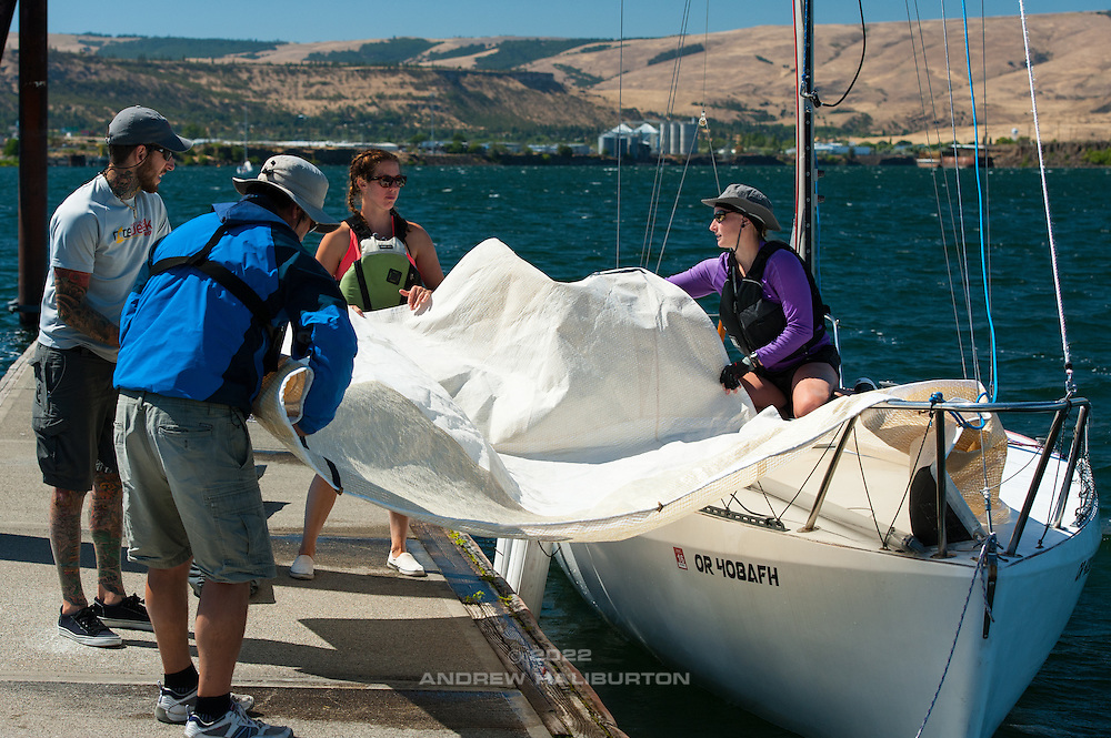 "Moore 24 #47 ""Moorality"" with crew: Stephanie Rice, Cathy Meyer, Blain Goold and Josh Raymond.  Double Damned Yacht Race from Cascade Locks to The Dalles, Oregon, USA. 6 August 2016.  The Moore 24, designed by George Olson and Ron Moore, was one of the first ultralight displacement sailboats, or ULDBs.  Production 1972-1988."