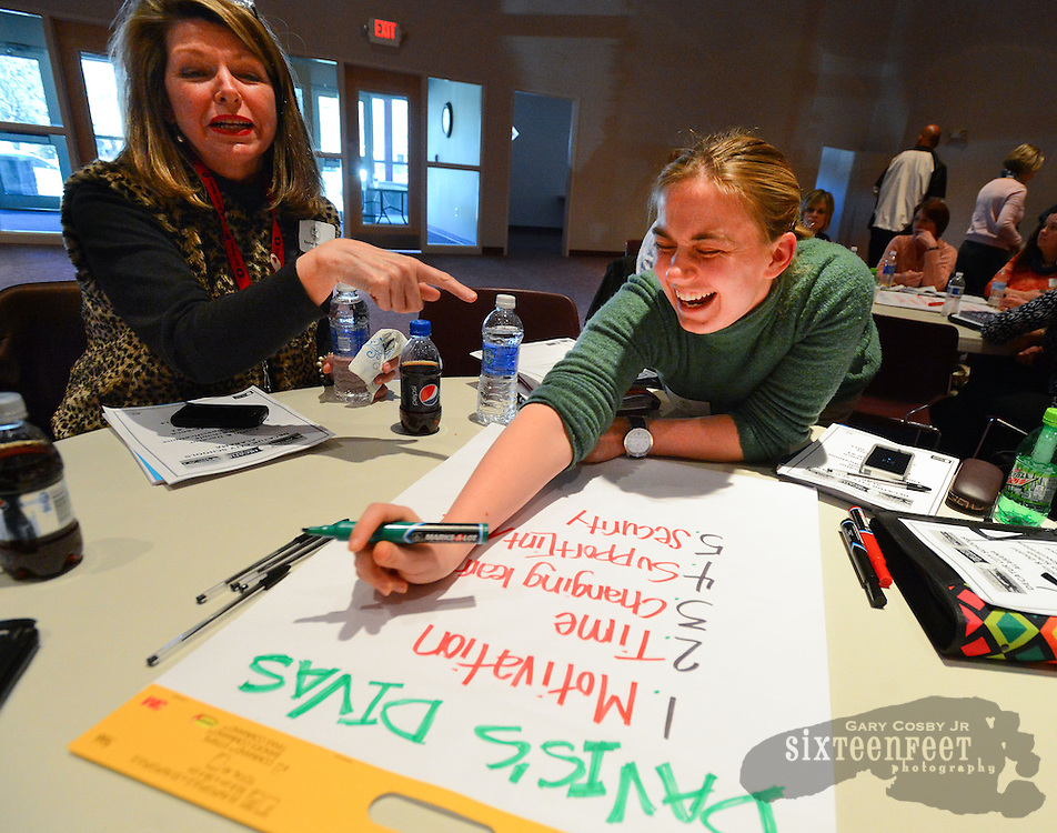 Gary Cosby Jr./Decatur Daily    Educators, administrators, students and parents meet at the Turner Surles Center for a planning session for Decatur's new high schools.  Rachel Brannon and Emily Harris have a laugh as they work on priorities for a new school.