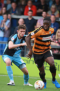 John Akinde shields the ball from Dan Rowe during the Sky Bet League 2 match between Barnet and Wycombe Wanderers at Underhill Stadium, London, England on 15 August 2015. Photo by Bennett Dean.