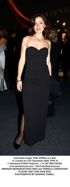 Australian singer TINA ARENA at a ball in London on 11th December 2003.PPN 75