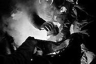 Napoli, Italia - 24 febbraio 2013. Un momento della protesta anti elettorale organizzata da un gruppo di tifosi della squadra di calcio del Napoli a piazza del Plebiscito nel capoluogo partenopeo. Circa 1000 ultras del calcio Napoli hanno bruciato le loro schede elettorali ed intonato cori contro l'attuale politica in viglore contro i membri del tifo organizzato..Ph. Roberto Salomone Ag. Controluce.ITALY - Supporters of SSC Napoli soccer team protest against the actual law against hooligans in Plebiscito square in Naples on February 24, 2013. Some 1000 supporters burned their elctoral cards