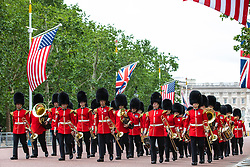 © Licensed to London News Pictures. 03/06/2019. London, UK. A marching band from the Queen's Guard march along The Mall from Buckingham Palace ahead of the arrival of President of the United States Donald Trump. President Trump is in the UK for a three-day State Visit. Photo credit: Rob Pinney/LNP