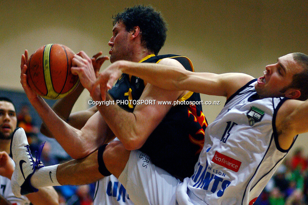 Pistons' Alex Pledger competes for the ball against Giants' Mike Fitchett. Bartercard NBL Semifinal, Waikato Pistons v Nelson Giants, Hamilton Boys High School, Hamilton, New Zealand. Friday 25th June 2010. Photo: Anthony Au-Yeung/PHOTOSPORT