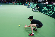 Ball boy catches the ball during the BNP Paribas Davis Cup 2014 between Poland and Croatia at Torwar Hall in Warsaw on April 6, 2014.<br /> <br /> Poland, Warsaw, April 6, 2014<br /> <br /> Picture also available in RAW (NEF) or TIFF format on special request.<br /> <br /> For editorial use only. Any commercial or promotional use requires permission.<br /> <br /> Mandatory credit:<br /> Photo by © Adam Nurkiewicz / Mediasport