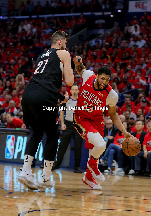 Apr 21, 2018; New Orleans, LA, USA; New Orleans Pelicans forward Anthony Davis (23) drives past Portland Trail Blazers center Jusuf Nurkic (27) during the first quarter in game four of the first round of the 2018 NBA Playoffs at the Smoothie King Center. Mandatory Credit: Derick E. Hingle-USA TODAY Sports