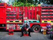 07 NOVEMBER 2017 - BANGKOK, THAILAND: A Coca Cola delivery man at a local market on Ekkamai Soi 30 in Bangkok.      PHOTO BY JACK KURTZ