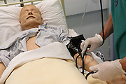 Phil, the OPD (Operating Department Practitioner) is measuring the pressure of a 'Patient Simulator' at the ExPERT Centre, a new wing of the University of Portsmouth, on Wednesday, March 28, 2007, in Portsmouth, England. The 'Patient Simulators' can bleed, breathe, drool and even speak, and are being used by students at the state-of-the-art new training centre. They cost 270.000 USD each and are able to simulate all sort of acute conditions, including heart attacks. The 'Patient Simulators' are housed at a $9 million USD centre which opened few weeks ago. Students and professionals from different health-care disciplines simulates conditions to then act and provide the right treatment, while the 'patient' will react accordingly. www.port.ac.uk/expertcentre  **Italy Out**