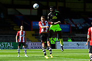 Jabo Ibehre (14) of Cambridge United jumps above Jordan Tillson (6) of Exeter City to head the ball during the EFL Sky Bet League 2 match between Exeter City and Cambridge United at St James' Park, Exeter, England on 5 August 2017. Photo by Graham Hunt.