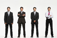 Businessmen standing side by side arms crossed by side clasped digitally enhanced