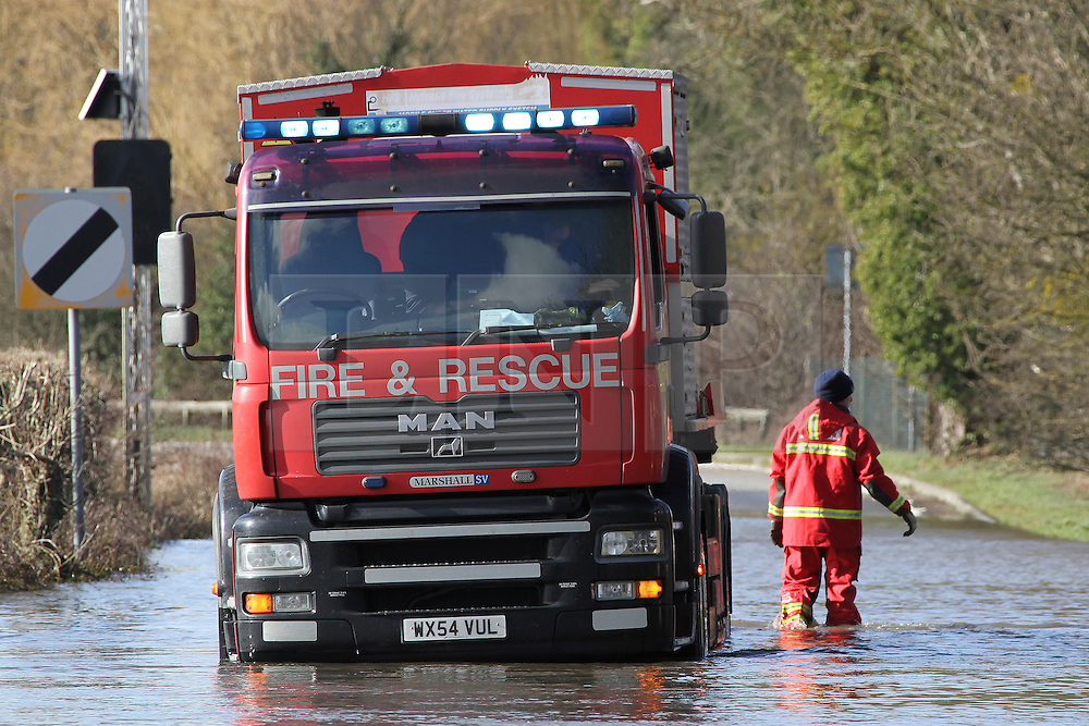 © Licensed to London News Pictures. 17/02/2014. Egham, UK.  Fire And Rescue Services Set up pumps to clear the A308 Windsor Road near Runnymede. Photo credit : John Maxwell-Roberts/LNP