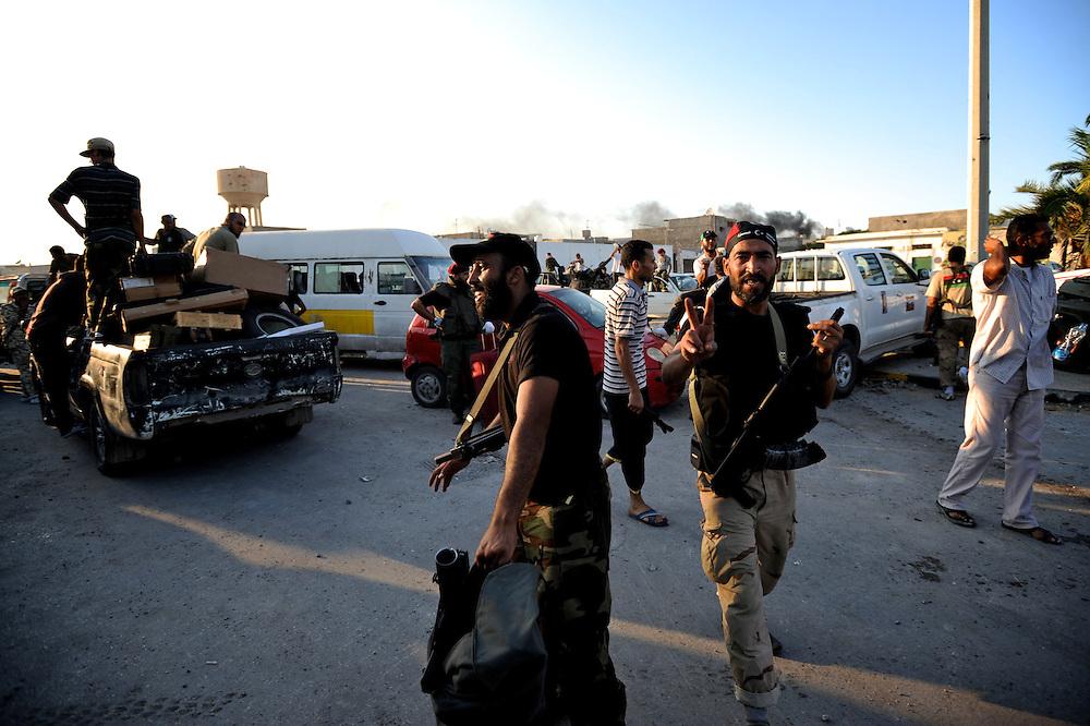 A group of rebels celebrate the take of Muammar Gaddafi's Bab Al Azizia compound in Tripoli.