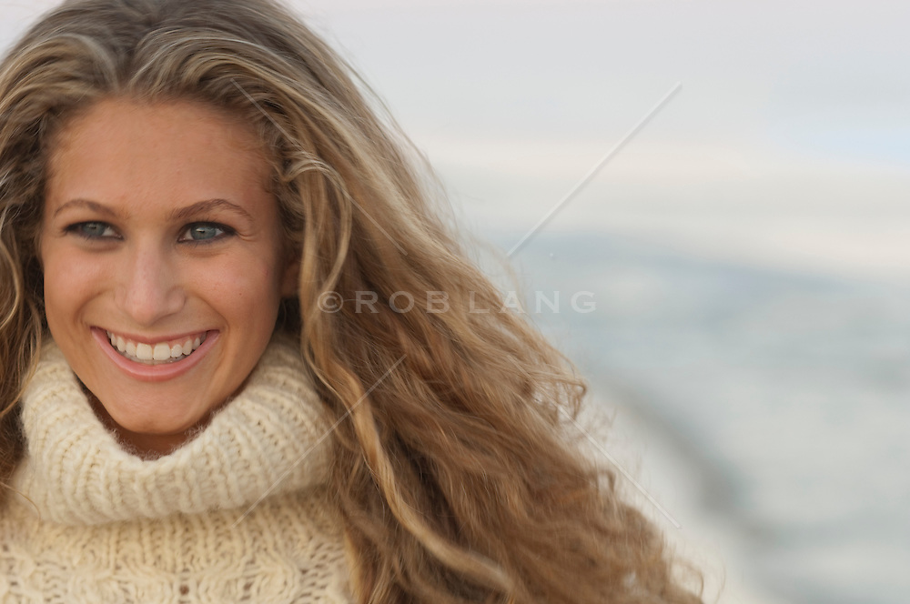 Portrait of a teenage girl outside on the beach in East Hampton, NY