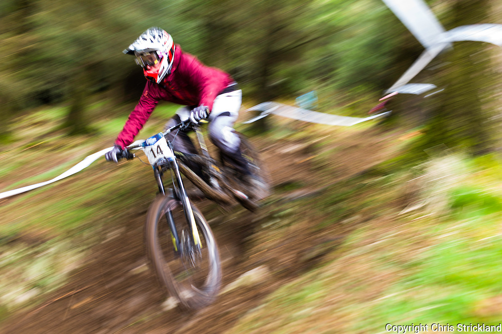 Ae Forest, Dumfries, Scotland, UK. 25th April 2015. Downhill Mountain Biker Joe Connell of Solid Reverse Racing takes on the 7Stanes course at Ae during the Scottish Downhill Association racing.